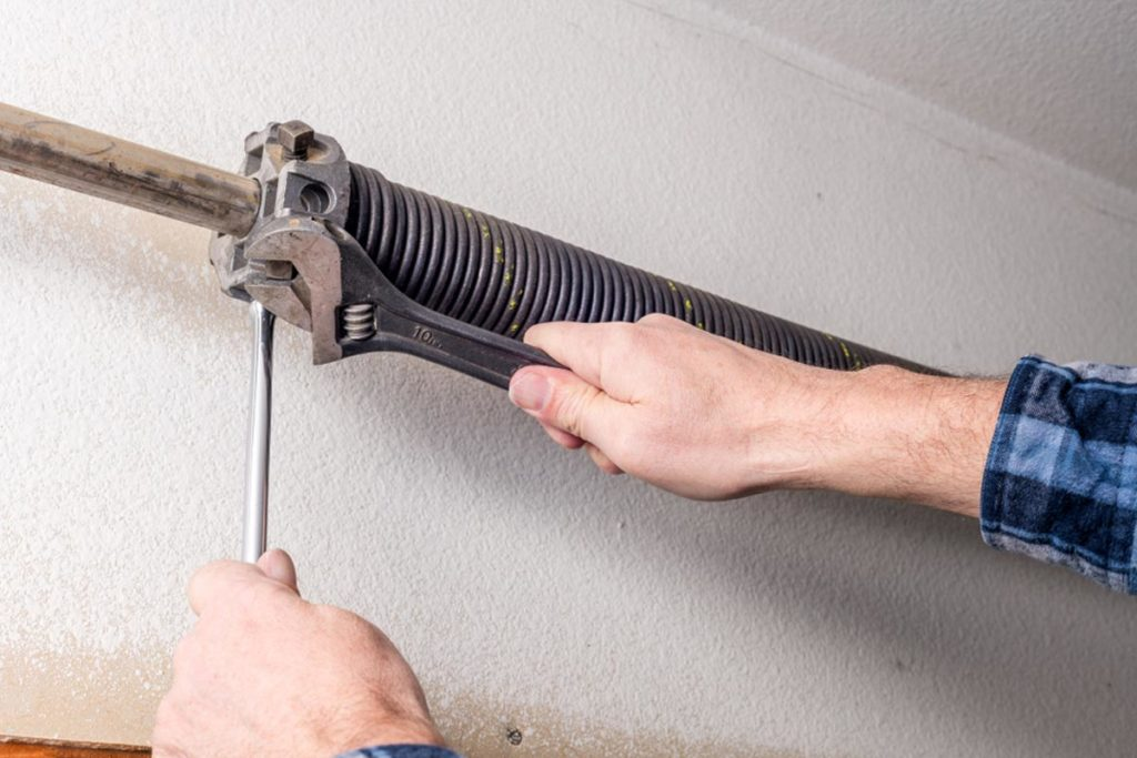 man tightening screws
